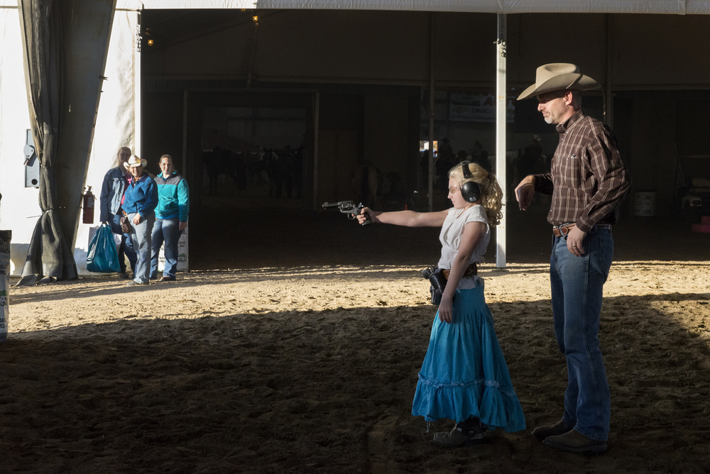 Eric Schreiber teaches Cate Westley, who is in the limited wrangler class, to shoot at a series of ground targets at the Congress shootout.