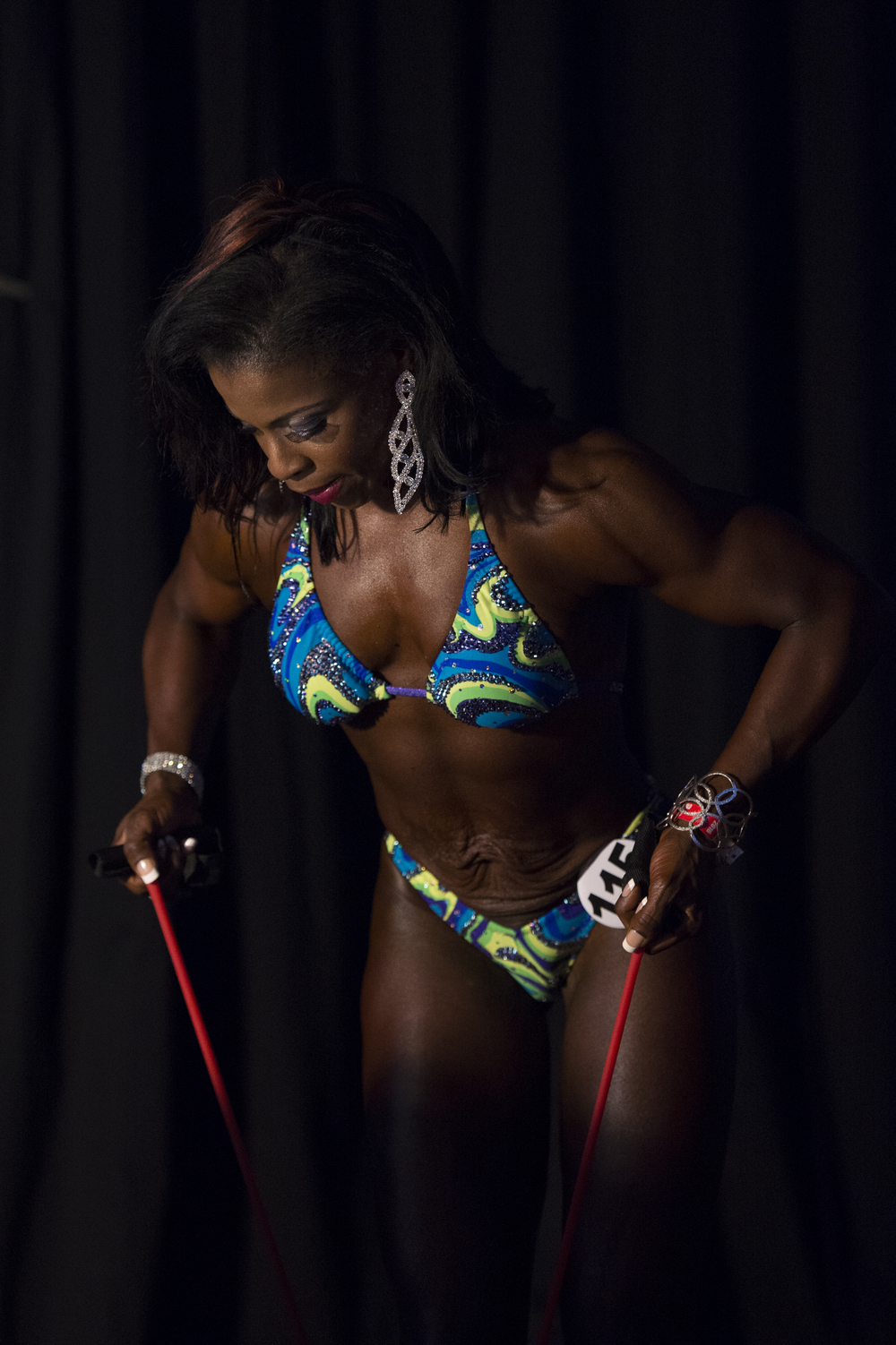 Michelle Bailey from Trinidad and Tobago warms up before heading on-stage for the Women's Bodyfitness Figure B pre-judging competition at Battelle Hall during the Arnold Sports Festival on Thursday, March 3, 2016.