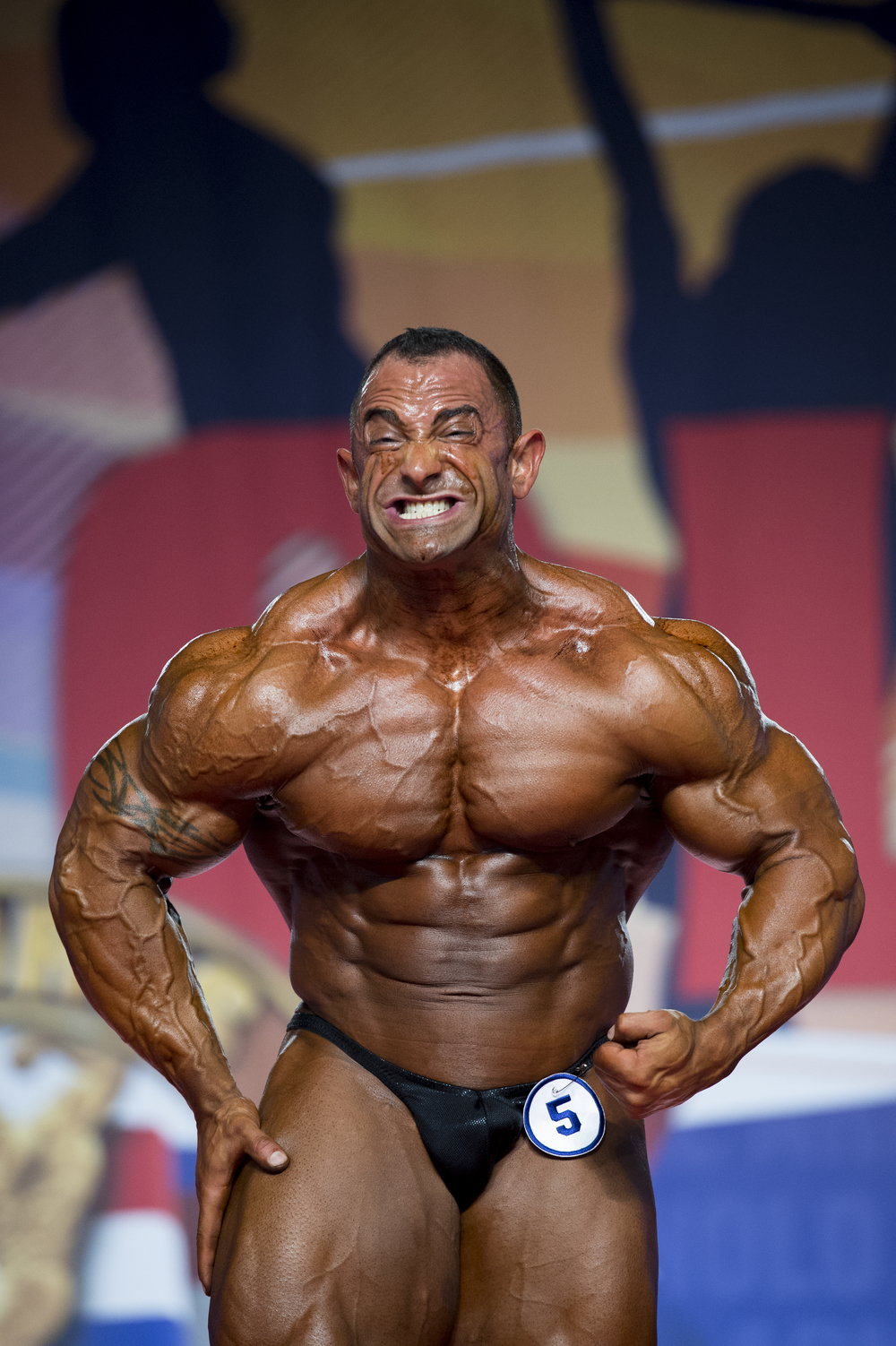 Guy Cisternino strikes an intense pose during the pose-down for the Arnold Classic 212 pre-judging at the Arnold Sports Festival on Friday, March 4, 2016.