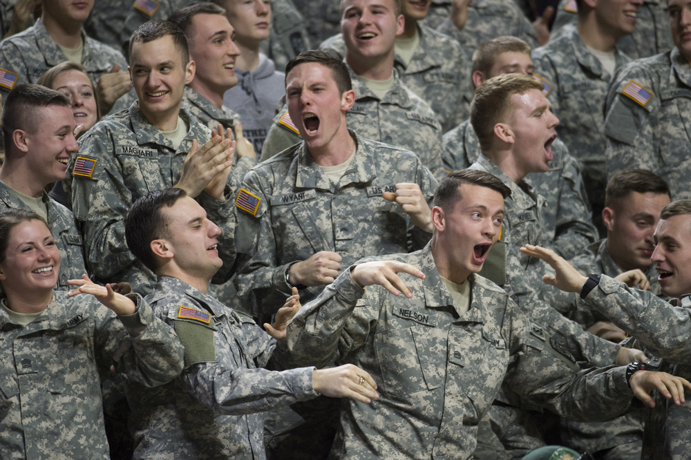 OU Army ROTC member Dillion Wyant celebrates with his comrades after the Bobcats scored against their Northern Illinois opponents at the Convocation Center in Athens, Ohio on Saturday, Feb. 6, 2016.