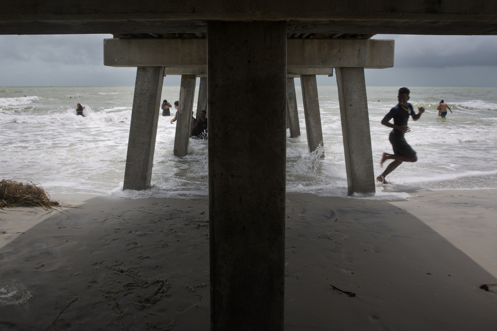 Students from several Naples schools celebrate their last day of school, closely monitored by local police, on the beach by Naples Pier on Tuesday, June 7, 2016.