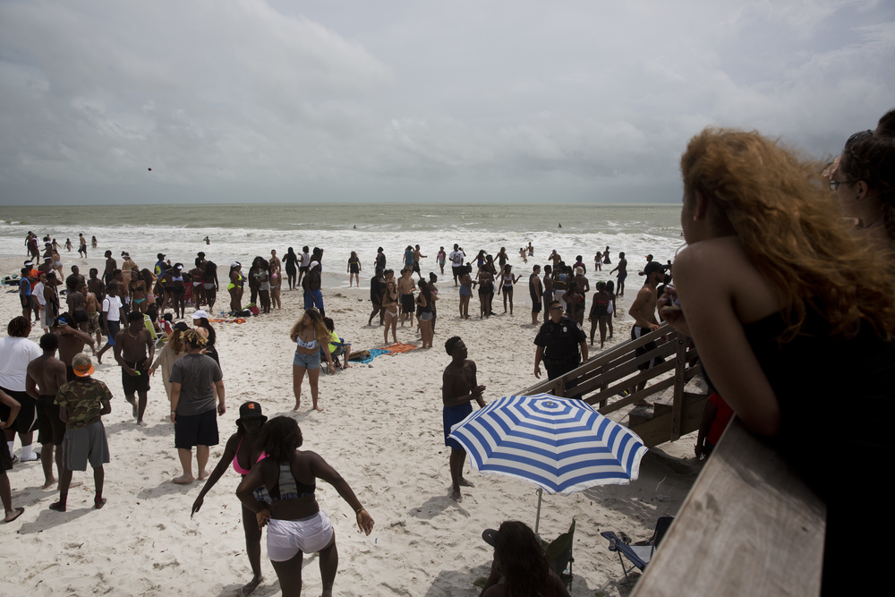 Students from multiple Naples schools celebrate their last day of school, closely monitored by local police, at the beach by Naples Pier on Tuesday, June 7, 2016.
