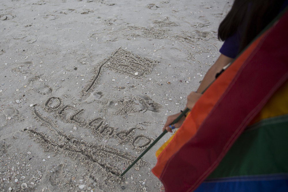 Morgan Tocco, 10, of Naples, draws the LGBT flag in the sand at a seaside vigil for the victims of the Pulse nightclub shooting in Orlando by the Naples pier on June 21, 2016. Morgan hoped her drawing would attract some people from the beach to participate in the event.