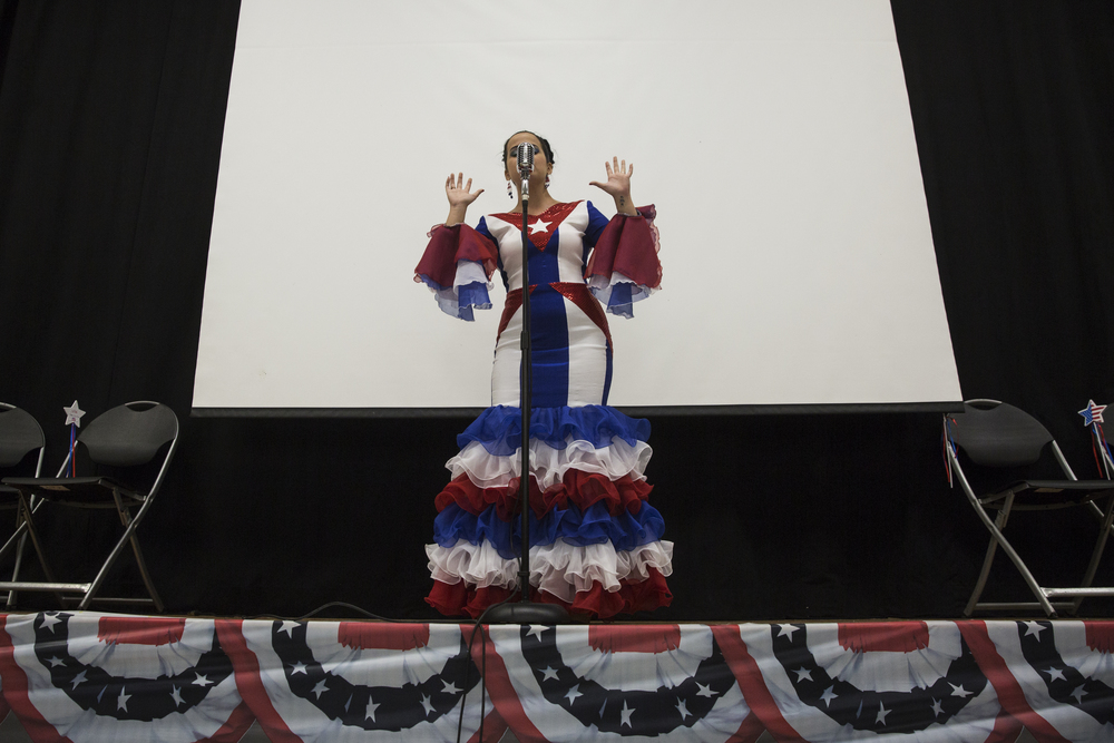 Lopez Diaz, of Cuba, sings following the Citizenship Ceremony on World Refugee Day at Golden Gate Community Center on June 25, 2016 in Naples, Florida.