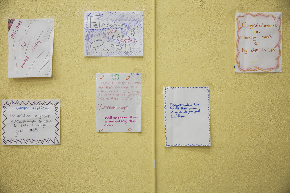 Congratulatory signs hang in the Golden Gate Community Center for World Refugee Day on June 25, 2016 in Naples, Florida. The signs, which hung on the walls around the room, were made as an end of the year project by students at Fort Myers Middle Academy, PACE Center for Girls and Discovery Montessori School in Jacksonville Beach.