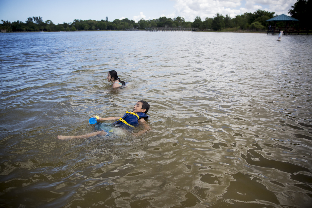 Aries Ayala, 6, swims with his cousin Jessica Garcia, 8, both of Naples, in Lake Avalon at Sugden Regional Park on June 23, 2016 in Naples, Florida.
