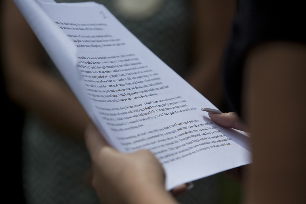 A woman reads from the Stanford Sexual Assault victim's letter at the Stanford Rape Protest at Mercato on Saturday, June 11, 2016 in Naples, Florida.