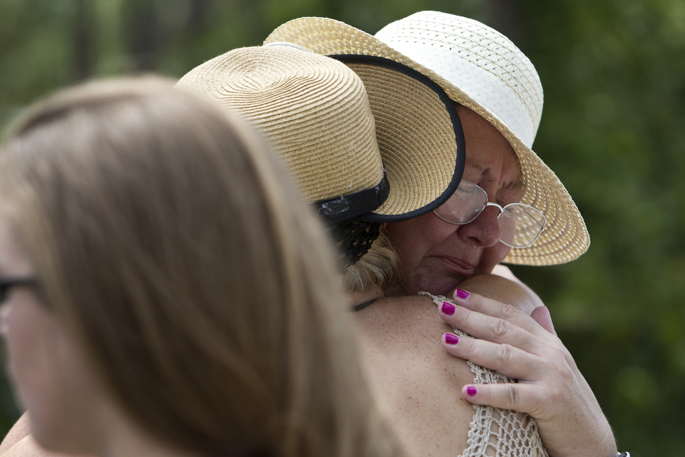 """Tamara Paquette consoles Tamara Gossard, who became upset after reading the victim's letter, at the Stanford Rape Protest at Mercato on Saturday, June 11, 2016 in Naples, Florida. The group """"20 Minutes of Action for Emily Doe"""" travelled to several locations throughout Naples to take turns reading the victim's letter to her attacker to raise awareness about the Stanford case."""