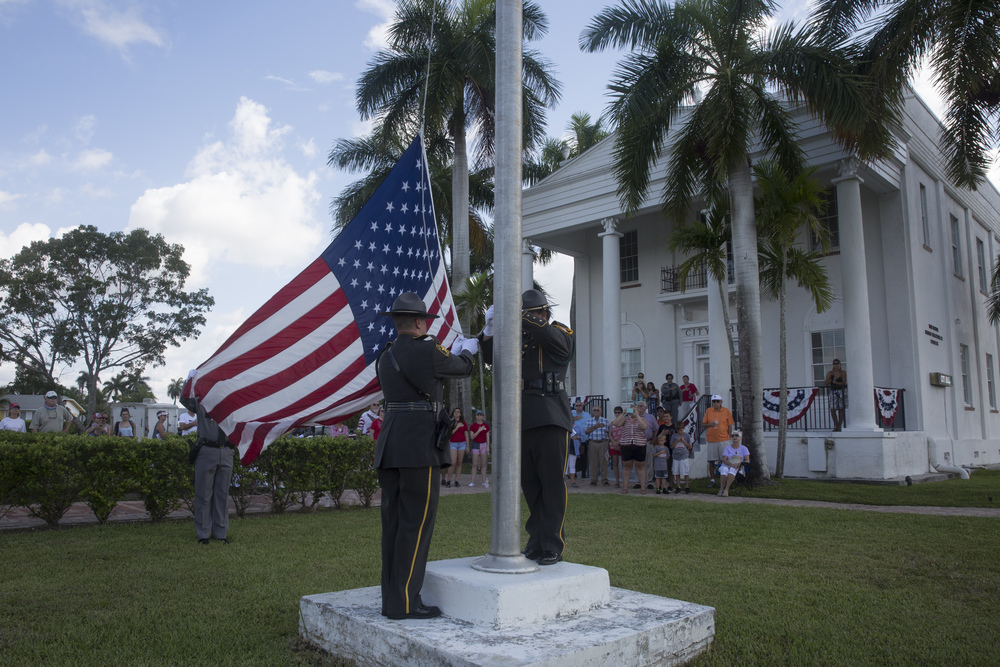 Sheriffs raise the flag during the opening ceremony of the early-bird Fourth of July Parade on July 2, 2015 in Everglades City, Florida.