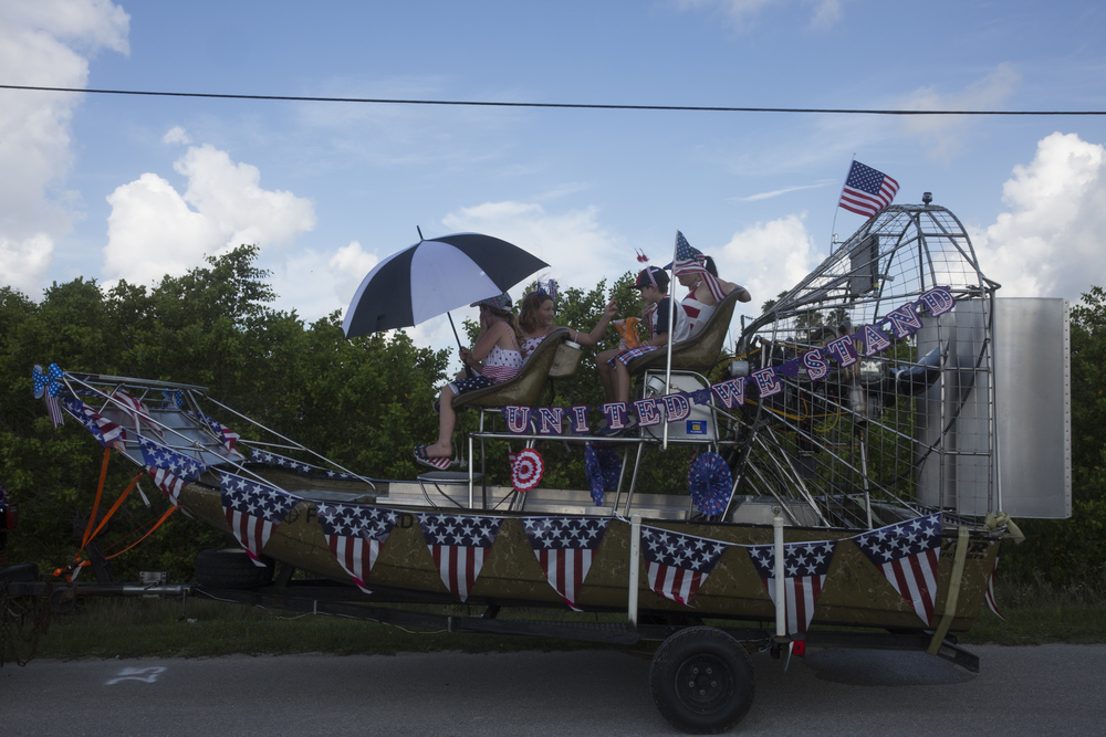 Parade participants wait in their airboat float before the early-bird Fourth of July Parade on July 2, 2015 in Everglades City, Florida.