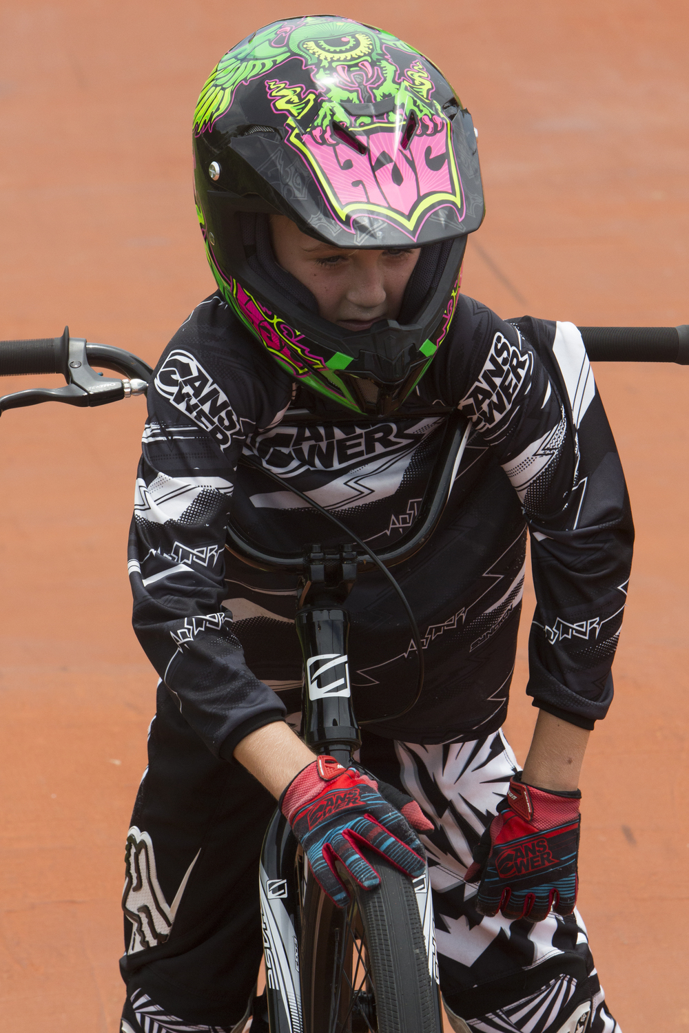 Chase Polley, 10, of Naples, catches his breath during BMX camp at the Golden Gate Wheels skate and BMX park on July 12, 2016.