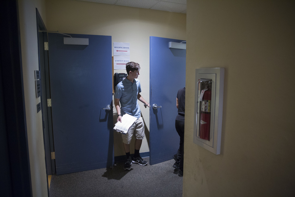 Michael Bruno holds the audition room door open during the Rocky Horror Picture Show production auditions at the Sugden Community Theatre on July 23, 2016 in Naples, Florida.