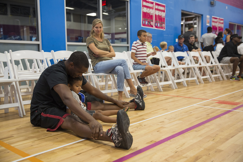 NFL free agent Carlos Singleton warms up with his son Miles Singleton, 2, before the 2nd Annual All-Star Basketball Game at the Greater Naples Y.M.C.A. on July 23, 2016 in Naples, Florida.