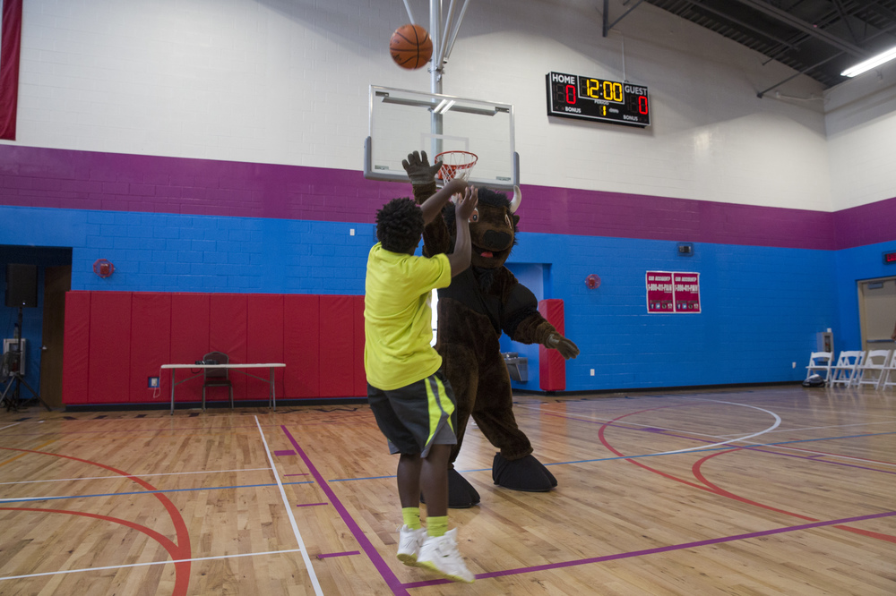 Martavion Young, 10, of Naples, shoots the ball against the mascot before the 2nd Annual All-Star Basketball Game at the Greater Naples Y.M.C.A. on July 23, 2016 in Naples, Florida.