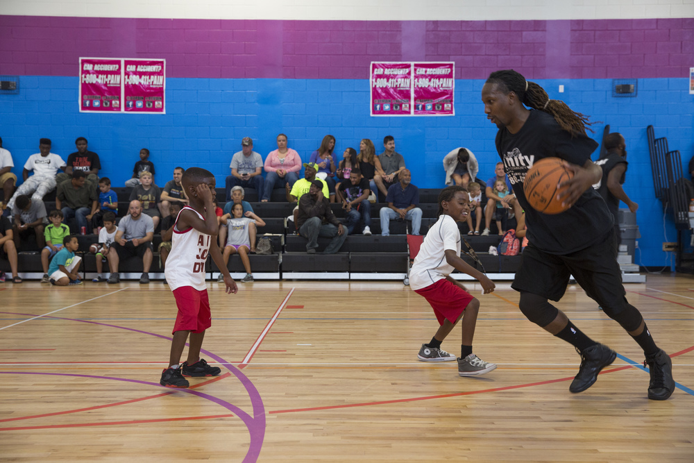 Mason Carter, right, plays basketball with some kids before the 2nd Annual All-Star Basketball Game at the Greater Naples Y.M.C.A. on July 23, 2016 in Naples, Florida.