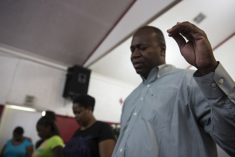 Deacon Nelson Lewis leads a prayer at the vigil for Stef'An Strawder at St. Mary's Missionary's Baptist Church on July 25, 2016 in Fort Myers, Florida. Stef'An was killed in a shooting at Club Blu the night before.