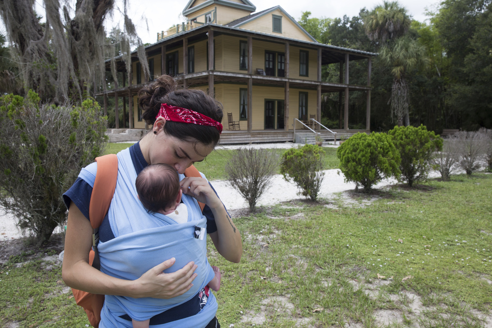 Brooklyn Cahill, 23, of Fort Myers, has a moment with her daughter Ophelia Cahill, 1 month, outside the Planetary Court at the Koreshan State Historic Site in Estero, Florida on July 27, 2016.The site contains areas of pine flatwoods habitat, a nature walk and the settlement of a religious colony, the Koreshan Unity, whose last members deeded the land to the state in 1961.