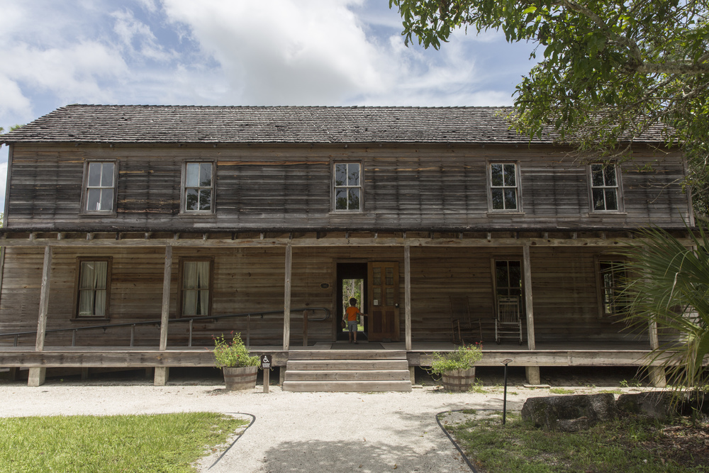 Landon Cahill, 6, of Fort Myers, enters the Founders Residence at the Koreshan State Historic Site in Estero, Florida on July 27, 2016.