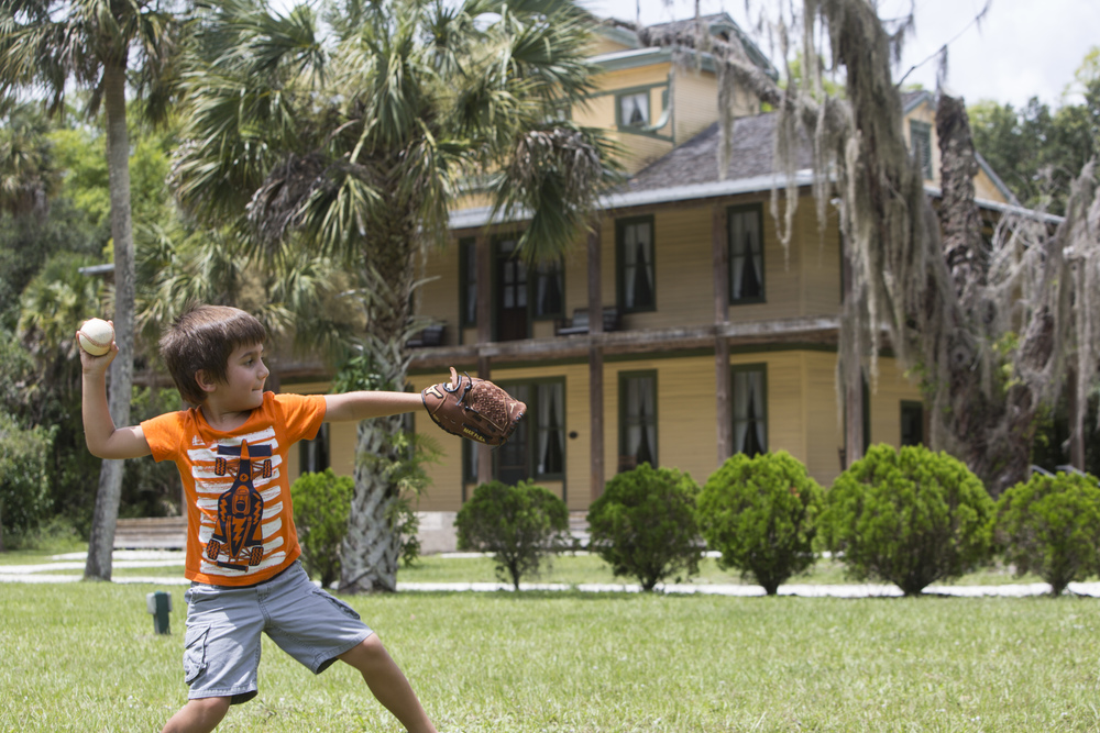 Landon Cahill, 6, of Fort Myers, plays catch with his dad at the Koreshan State Historic Site in Estero, Florida on July 27, 2016.