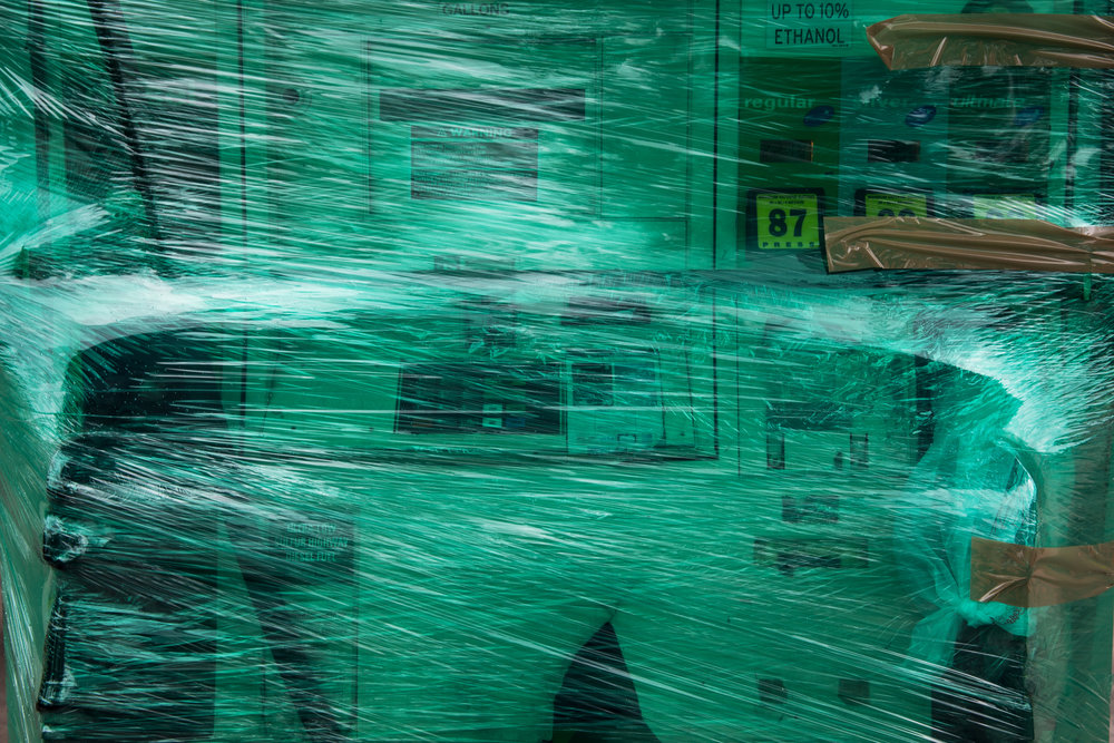 Saran wrap covers an empty gas pump at a BP Gas Station in Fort Lauderdale, Florida on Thursday, Oct. 6, 2016.