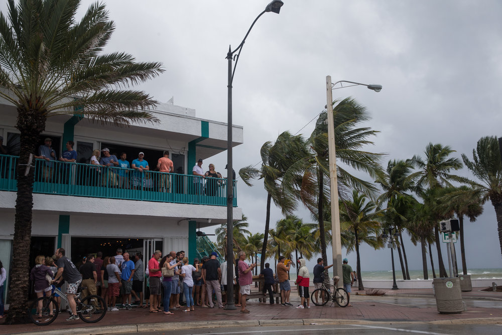 People crowd the Elbo Room bar during the storm at Fort Lauderdale Beach, Florida on Thursday, Oct. 6, 2016.