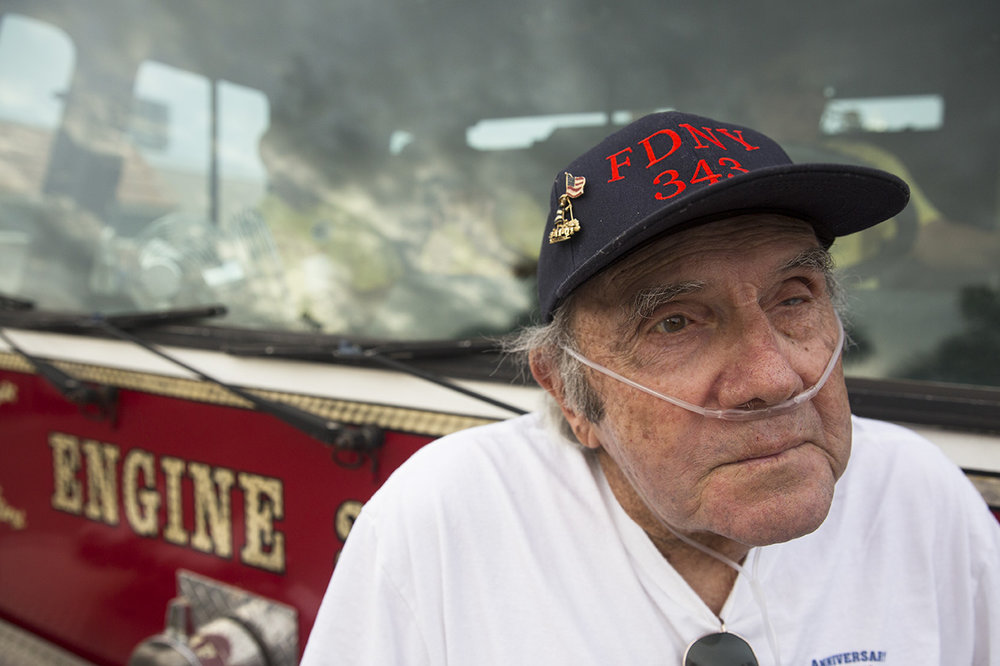 Richard Gibbons, who spent 25 years with the Naples Fire Department before retiring in 1997, poses for a portrait during the pizza fundraiser at Cosmos Cafe & Pizzeria in Naples on August 3, 2016. The fundraiser benefited the Collier County 100 Club, an organization that provides financial assistance to families of Southwest Florida law enforcement officers and first responders who have died in the line of duty.