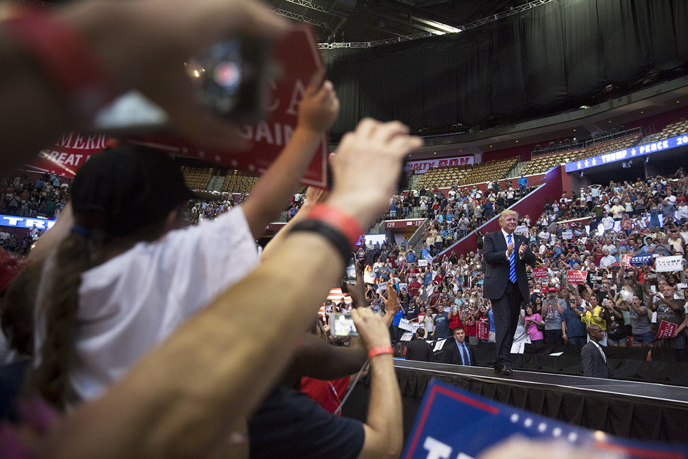 Republican Presidential nominee Donald Trump takes the stage during his rally at the BB&T Center in Fort Lauderdale, Florida on August 10, 2016.