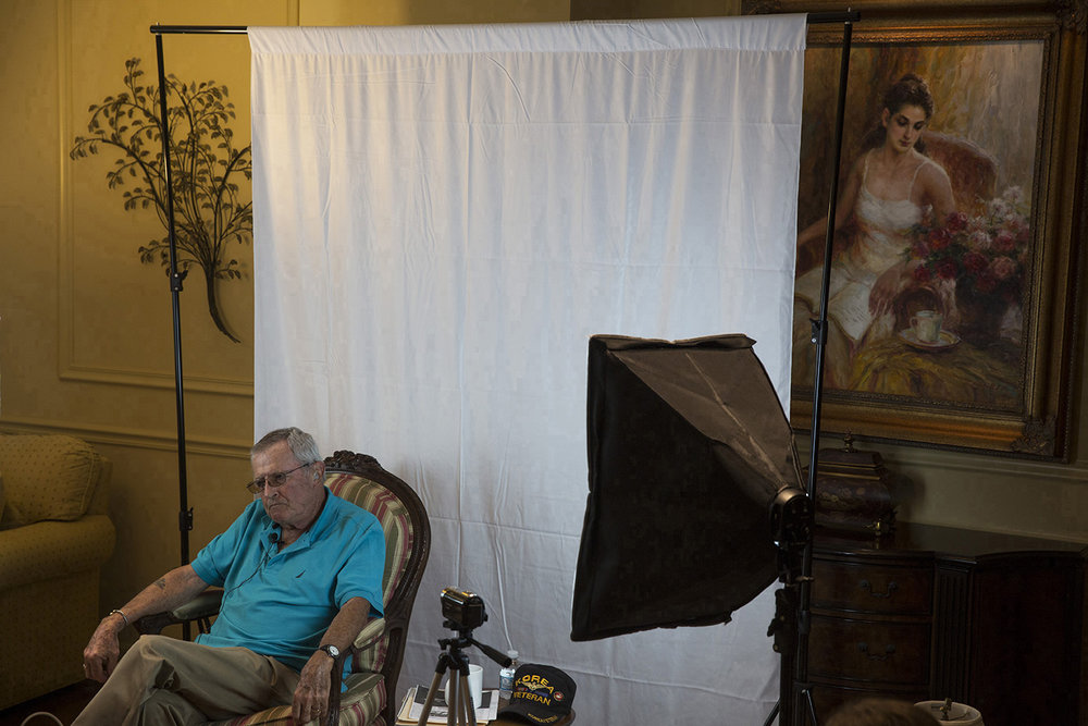 Jeremy Leon, 84, a Korean War veteran, sits for an interview with local high school students on August 3, 2016 in Naples, Florida. Dayna Grigsby and Hannah Legutki, both juniors at Barron Collier and Naples High, respectively, have launched an initiative to capture video interviews with Korean War veterans, providing first-hand accounts and memories of the 1950-1953 war.