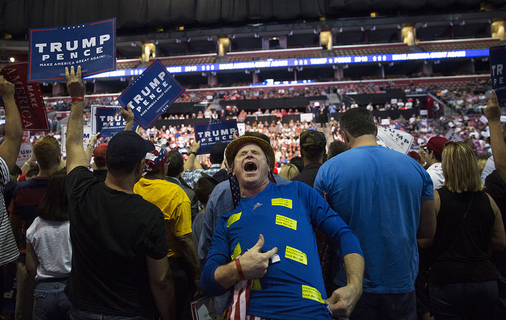 """A Trump supporter passionately shouts """"Lock her up!"""" in reference to Hillary Clinton during the Donald Trump rally at the BB&T Center in Fort Lauderdale, Florida on August 10, 2016."""