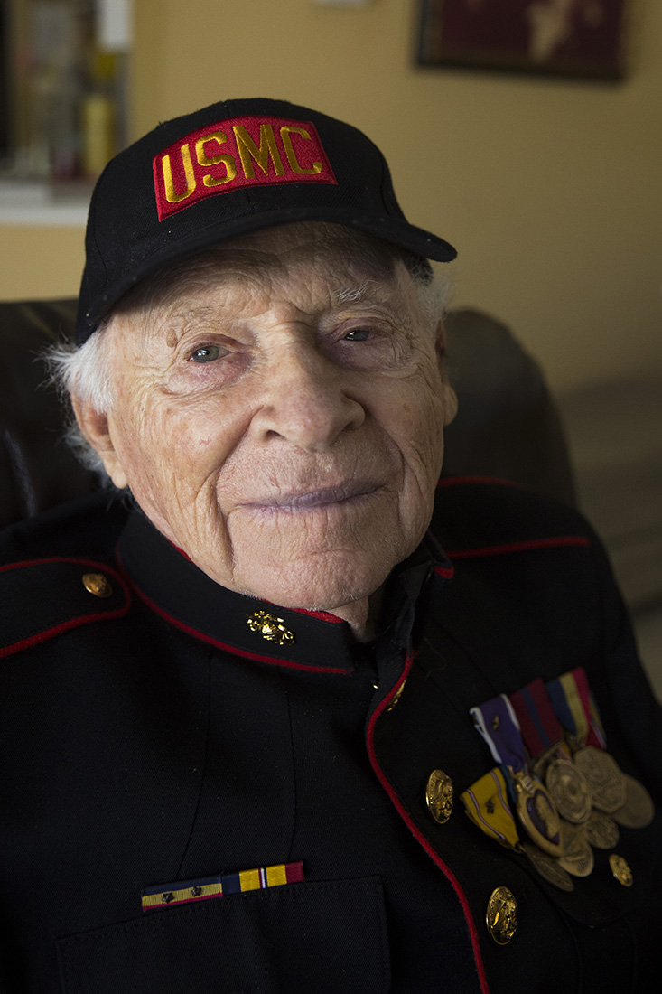 """Corporal Edwin Glasberg, 92, in his home in Naples, Florida on August 5, 2016. Glasberg received two Purple Heart medals for wounds sustained in Pacific battles, and a Presidential Unit Citation medal, awarded for """"extraordinary heroism in action against an armed enemy."""""""