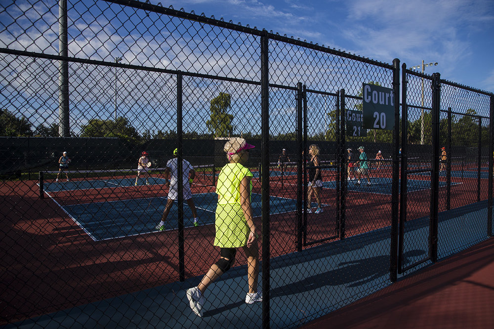 A woman walks between courts for a pick-up pickleball game at East Naples Community Park on Wednesday, Sept. 7, 2016 in Naples, Florida. Due to last years success, organizers want to extend the contract to host the US Open Pickleball Championships in Collier County for another five years.