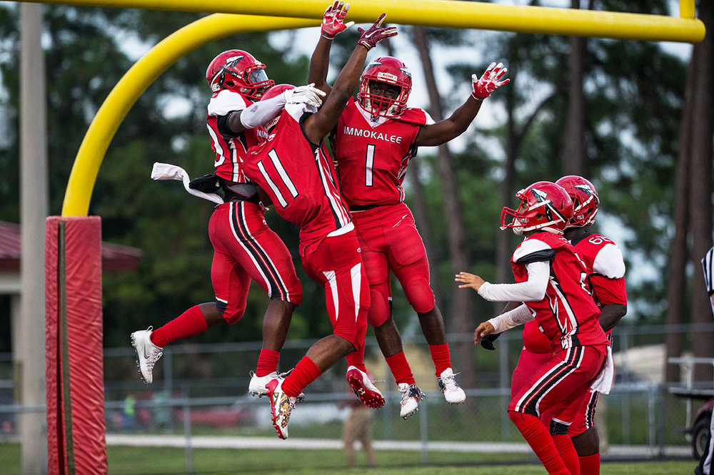Immokalee wide reciever  Abraham Ruiz, #11, celebrates his touchtown in the end zone with his teammates during the Harvest Bowl matchup at Gary Bates Stadium in Immokalee, Florida on Friday Sept. 2, 2016. The Tigers defeated the Indians 20-17.