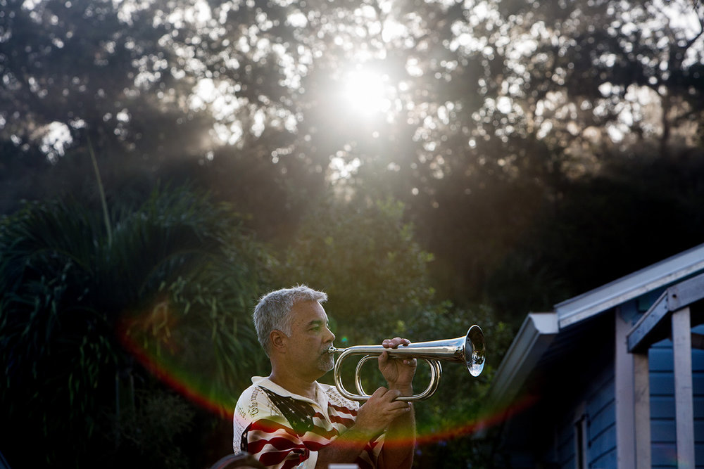 """Adam Prentki plays the bugle call """"taps"""" during the Bonita Springs Patriot Day Service at the Liles Hotel Plaza on Sunday, Sept. 11, 2016. The service included a 21 Gun Salute, the playing of 'Taps,' musical tributes, and the sounding of a final alarm bell."""