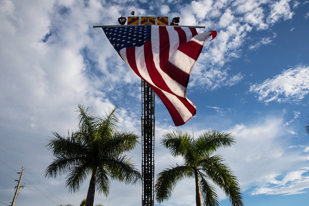The American Flag waves in the wind during the Bonita Springs Patriot Day Service at the Liles Hotel Plaza on Sunday, Sept. 11, 2016. The service included a 21 Gun Salute, the playing of 'Taps,' musical tributes, and the sounding of a final alarm bell.