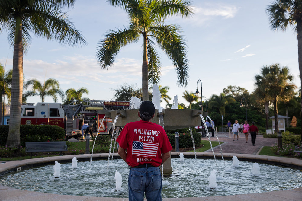 A man takes a moment to himself in the Liles Hotel Plaza during the Bonita Springs Patriot Day Service on Sunday, Sept. 11, 2016. The service included a 21 Gun Salute, the playing of 'Taps,' musical tributes, and the sounding of a final alarm bell.