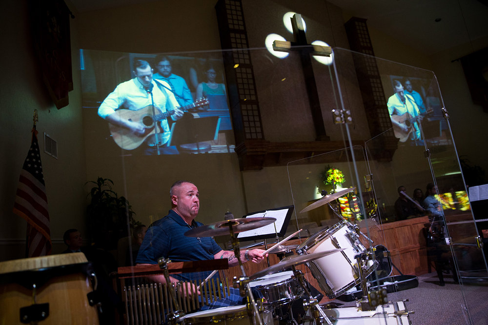 Band of Brothers drummer Jason Pappalardo, front left, plays the kit while Spencer Barney plays guitar and sings during the St. Matthews benefit concert at East Naples United Methodist Church on Sunday, Sept. 18, 2016. St. Matthew's House strives to fight hunger, homelessness, and addiction in SW Florida.