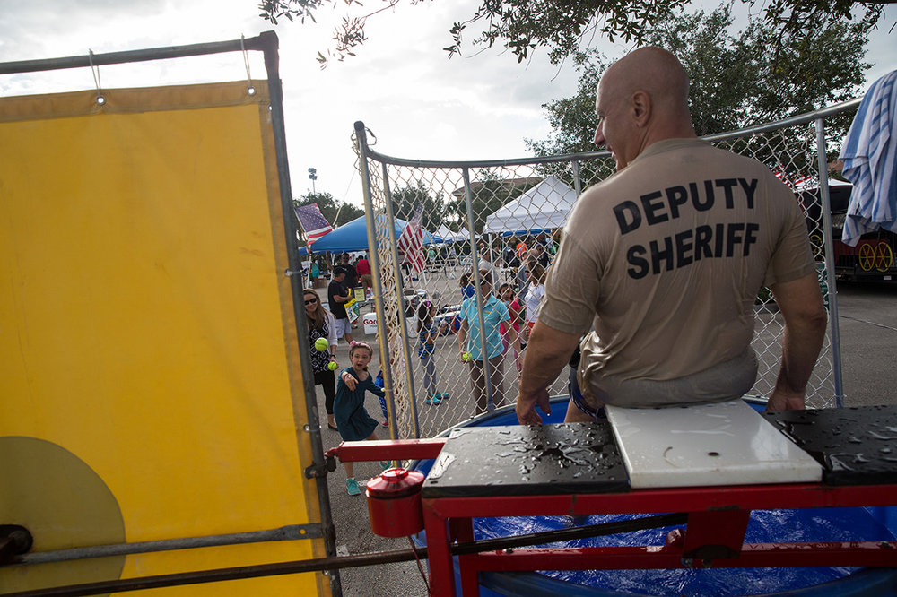 Ellie Golden, 10, left, throws a ball to dunk Officer Rich Stoneson during the Celebrate Safe Communities event at the Vanderbilt Presbyterian Church on Monday, Oct. 10, 2016 in Naples, Florida. Other festivities included cookouts, bounce houses, wall climbing, and refreshments. Celebrating Safe Communities is designed to heighten crime prevention and drug prevention awareness; generate support for and participation in local anti-crime efforts; and strengthen neighborhood spirit and police-community partnerships.