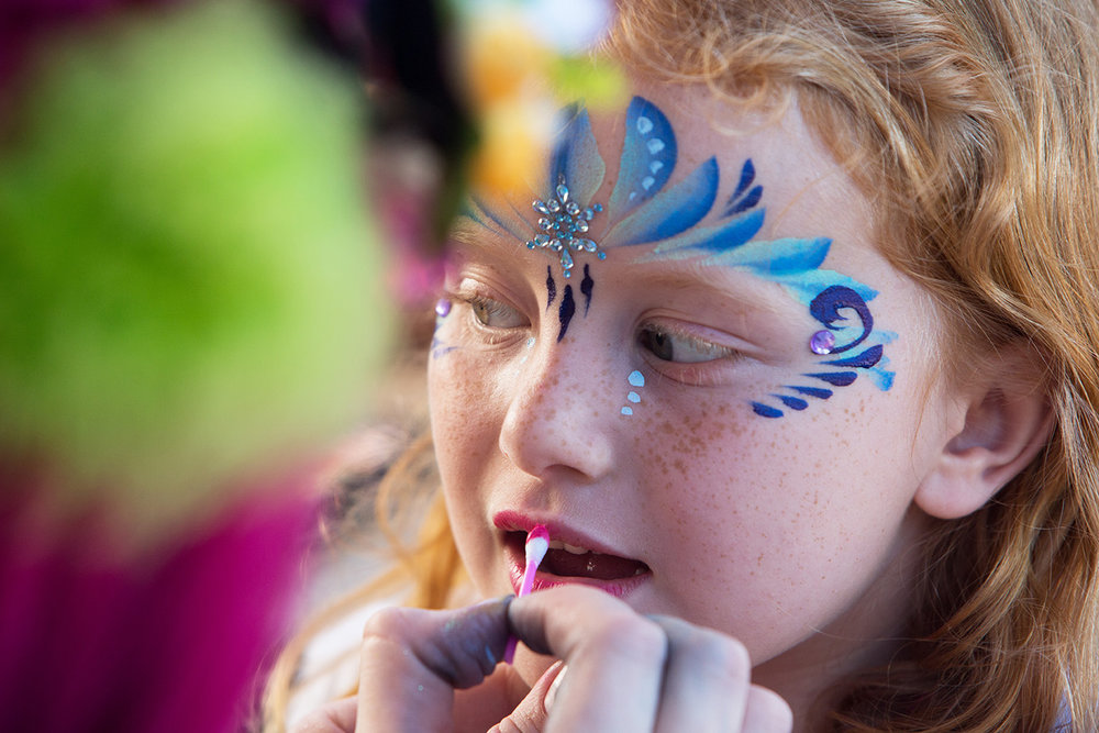 Julia Waters, 6, has lipstick applied during a face painting session at the Celebrate Safe Communities event at the Vanderbilt Presbyterian Church on Monday, Oct. 10, 2016 in Naples, Florida. Other festivities included cookouts, bounce houses, wall climbing, and refreshments.