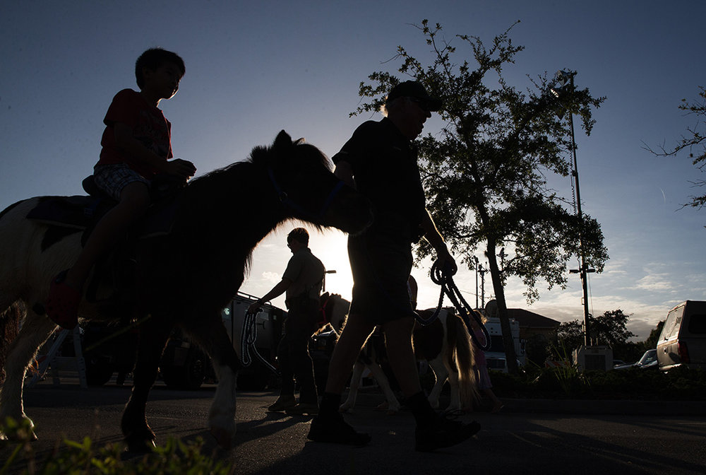 Kids ride ponies during the Celebrate Safe Communities event at the Vanderbilt Presbyterian Church on Monday, Oct. 10, 2016 in Naples, Florida.