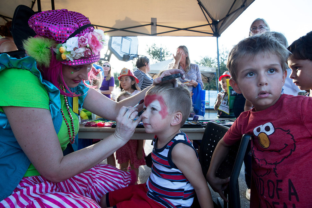 Jayden Emmons, 3, center, gets his face painted during the Celebrate Safe Communities event at the Vanderbilt Presbyterian Church on Monday, Oct. 10, 2016 in Naples, Florida.