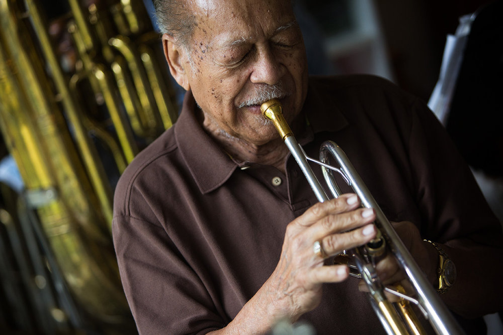 """Renald Richard, 91, plays the trumpet during a jazz jam session at the home of Jim Gover in Naples, Florida on Tuesday, Oct. 11, 2016. Although members come and go, the group has been meeting every Tuesday for the past eight years. Richard was Ray Charles' former band leader and co-wrote his hit song """"I Got a Woman."""""""