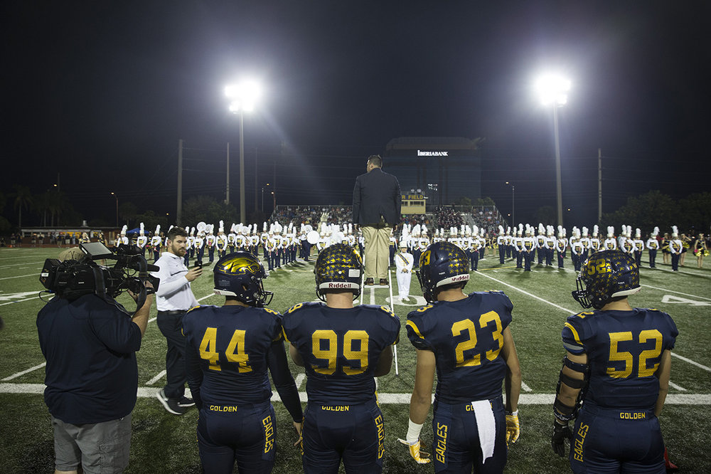 The Naples Golden Eagles captains wait on the sidelines before the start of their matchup against the South Fort Myers Wolfpack at Staver Field on Friday, Oct. 21, 2016 in Naples, Florida. The Wolfpack defeated the Eagles 42-35.