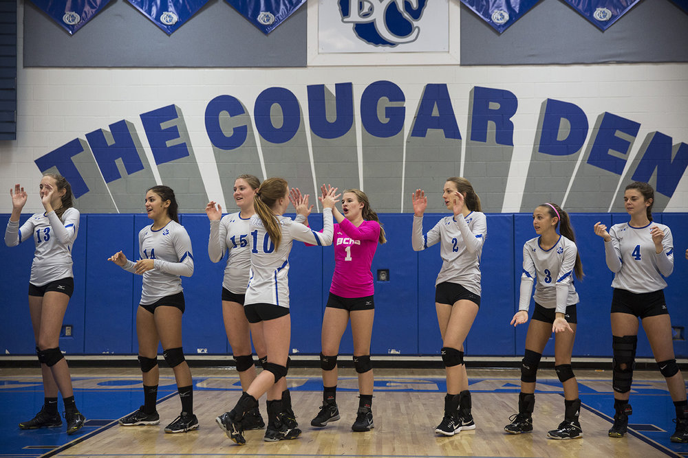 Shey Kirwin, #10, high fives teammate Lexie Hamilton, #1, during the player introductions before the Class 7A regional quarterfinal volleyball game against Estero at Barron Collier High School on Tuesday, Oct. 25, 2016 in Naples, Florida. Barron Collier would go on to win 3-0, advancing to the regional semifinal game.