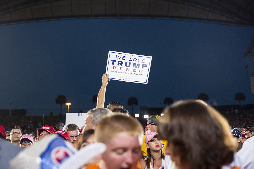 Donald Trump supporters cheer and hold up signs as Republican presidential nominee Donald Trump speaks during his rally at MIDFLORIDA Credit Union Amphitheater in Tampa, Florida on Monday, Oct. 24, 2016.