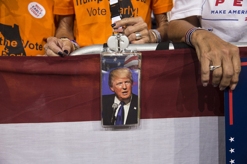 A photo of Donald Trump hangs over the crowd barrier during a rally for Republican presidential nominee Donald Trump at MIDFLORIDA Credit Union Amphitheater in Tampa, Florida on Monday, Oct. 24, 2016.