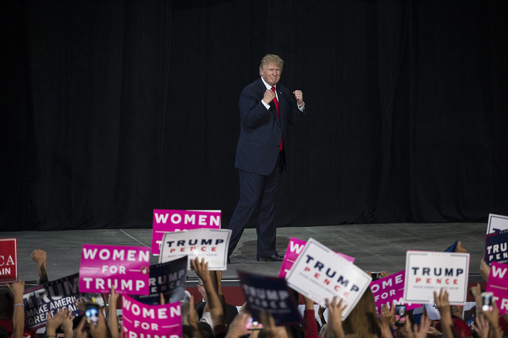 Republican presidential nominee Donald Trump pumps up the crowd after his rally speech at MIDFLORIDA Credit Union Amphitheater in Tampa, Florida on Monday, Oct. 24, 2016.