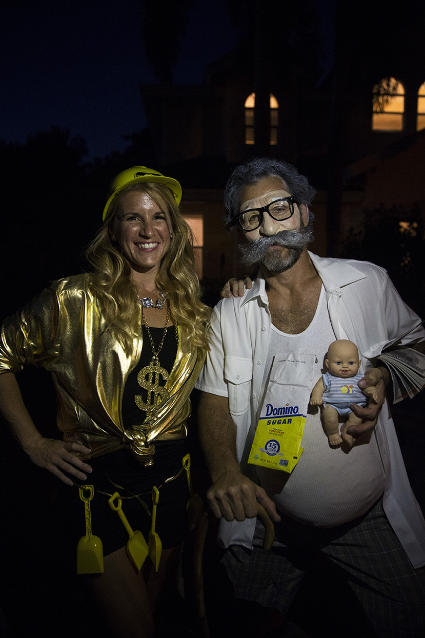 Rebecca Trucksess and Doug Haughey, dressed as a gold digger and sugar daddy respectively, pose for a portrait while trick-or-treating in the Lake Park neighborhood of Naples, Florida on Monday, Oct. 31, 2016.