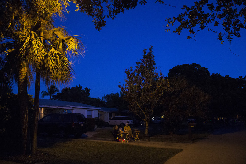 People wait for trick-or-treaters to come to their house in the Lake Park neighborhood of Naples, Florida on Monday, Oct. 31, 2016.