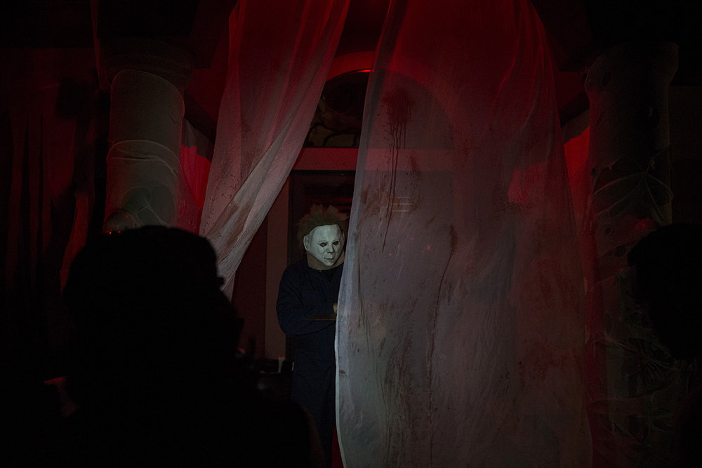 Jimmy Nocera, dressed as the infamous Michael Myers, hands out candy to trick-or-treaters in the Lake Park neighborhood of Naples, Florida on Monday, Oct. 31, 2016. He and his family have dressed and decorated their house the same way for the past 10 years.