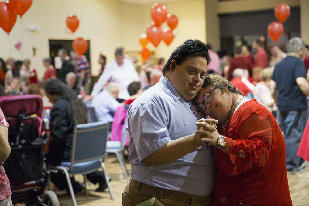 Brigitte Butz leans on Alex Perez's shoulder as they slow dance during the 28th Annual Valentine's Dinner Dance at Emmanuel Lutheran Church in Naples, Florida on Friday, Feb. 10, 2017. Naples Civitan Club hosts the event for members of the Foundation for the Developmentally Disabled.